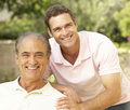 Father and Adult Son Stock Images