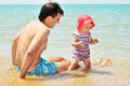 Father with baby on the beach are having fun Royalty Free Stock Photography