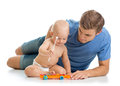 Father and baby boy have fun with musical toys. Isolated on wh Royalty Free Stock Photo