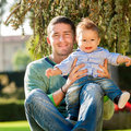 Father with baby playing on the park Stock Photography