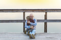 Father and baby son sitting on the wooden bridge. Royalty Free Stock Photo