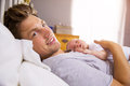 Father In Bed Holding Sleeping Newborn Baby Daughter Royalty Free Stock Photo