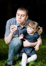 Father Blowing Soap Bubble Stock Photography