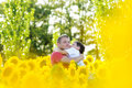 Father and boy in a sunflowers field white t shirt Stock Image