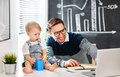 Father businessman and baby son working at computer