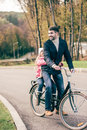 stock image of  Father carrying daughter on bike