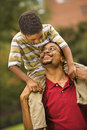 Father carrying son Stock Images