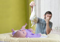 Father is changing stinky diapers. Care of baby with diarrhea Royalty Free Stock Photo
