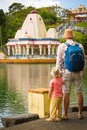 Father and child at Ganga Talao. Mauritius. Royalty Free Stock Photo