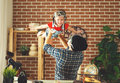 Father and child playing in the pilots dream of traveling Royalty Free Stock Photo
