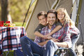 Father and children enjoying camping holiday in countryside Stock Image