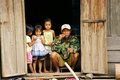 Father and children the ethnic minority family chidren sitting at door dalak september Stock Images