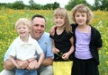Father and Children in Flower Field Royalty Free Stock Photo