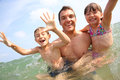 Father with children playing in ocean man enjoying sea bath Royalty Free Stock Photo