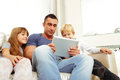Father with children playing on tablet computer Royalty Free Stock Photo