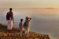 Father with children watching  sunset on top of mountain Royalty Free Stock Photo