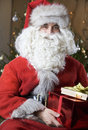 Father Christmas/Santa Claus holding a pile of presents Royalty Free Stock Photo