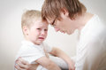 Father comforting son in tears her crying little parenthood concept Royalty Free Stock Photos