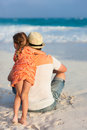 Father and daughter at beach back view of his little tropical Royalty Free Stock Photo