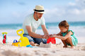 Father and daughter at beach on building sand castle Stock Image