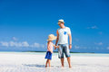 Father and daughter at beach deserted tropical Stock Photo