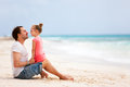 Father and daughter at beach enjoying holiday vacation Royalty Free Stock Photo