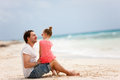 Father and daughter at beach enjoying holiday vacation Stock Photo