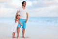 Father and daughter at beach happy his adorable little tropical Royalty Free Stock Image