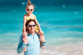 Father and daughter at beach happy his adorable little tropical having fun Royalty Free Stock Images