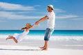 Father and daughter at beach happy his adorable little tropical having fun Stock Photo