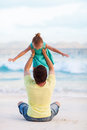Father and daughter at beach happy his sweet little Royalty Free Stock Photography