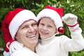 Father with daughter decoration on christmas tree Royalty Free Stock Images