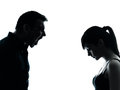 Father daughter dispute conflict one men and teenager girl in silhouette indoors isolated on white background Stock Photography