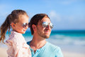 Father and daughter happy his adorable little at beach Stock Photos