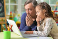 Father and daughter with laptop Royalty Free Stock Photo