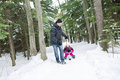 Father and daughter outdoor in the winter forest Royalty Free Stock Photo