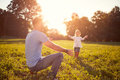 Father with daughter playing ball outdoor Royalty Free Stock Photo