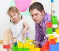 Father daughter playing coloured blocks Stock Images