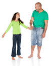 Father and daughter pretty cute caucasian girl wearing a green long sleeve top blue jeans is holding the hand of her Stock Photography