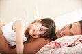 Father And Daughter Relaxing Together In Bed Royalty Free Stock Photo