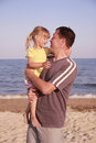 Father and daughter on the sea shore a Royalty Free Stock Photos
