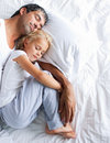Father and daughter sleeping on bed Royalty Free Stock Photo