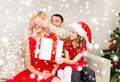 Father and daughter surprise mother with gift box family christmas x mas winter happiness people concept smiling big Royalty Free Stock Photography
