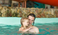 Father with daughter swim in aqua park Royalty Free Stock Photography