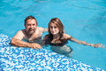 Father and daughter swimming in the poo happy family pool on a sunny day Stock Photography