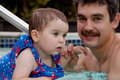 Father and daughter in a swimming pool on hot california day Stock Images