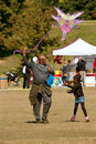 Father and daughter try to get kite to take flight atlanta ga usa october a their at the world festival at piedmont park Stock Images