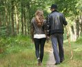 Father and daughter walking on path in the woods portrait of a from behind Stock Photography