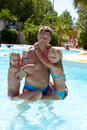 Father and daughters in the swim pool Royalty Free Stock Photo