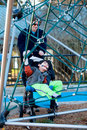 Father with disabled boy at the playground jungle gym Stock Photography